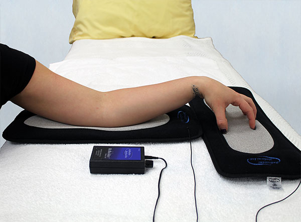 ReBuilder Footpads to treat arm for carpal tunnel discomfort