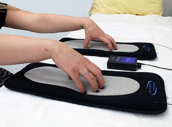 ReBuilder Footpads used to treat the tips of your fingers