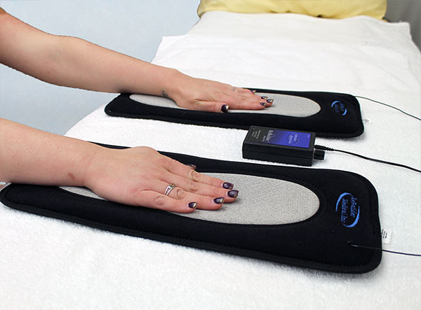 ReBuilder Footpads used to treat palms of your hands