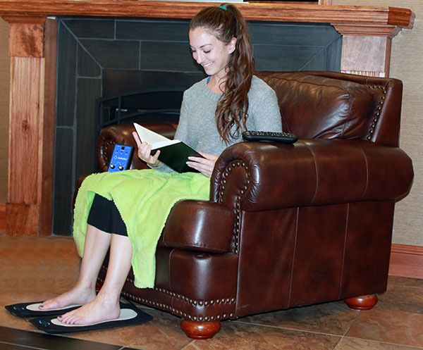 Girl using ReBuilder Footpads to treat her feet